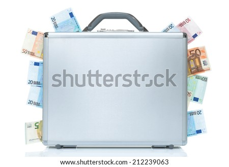 Silver briefcase with money coming out of the sides - stock photo