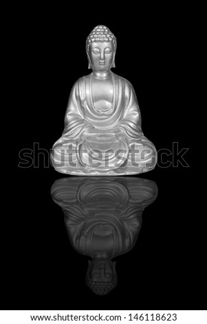 Silver Buddha statue isolated on black - stock photo