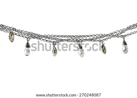 Silver chain with crystal pendants on white background - stock photo