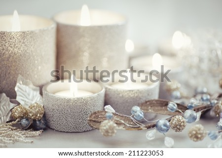Silver Christmas candles and ornaments.  - stock photo