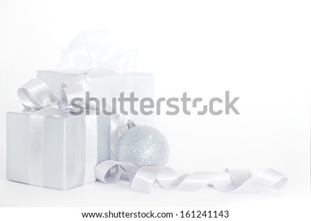 Silver christmas card with gifts and decoration - stock photo