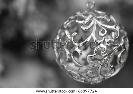 Silver christmas decoration with swirls - stock photo