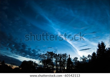 Silver clouds. An unusual occurrence around the white nights. Very high clouds are shone silver light against the night summer sky. - stock photo