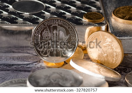Silver Coin Austrian Philharmonic with Gold coins & bars - stock photo