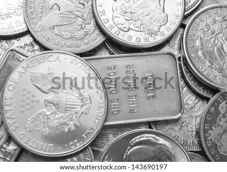 Silver coins and bars background - stock photo