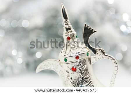 Silver colored Arabic Coffee pot in silver background.Ramadan Eid concept - stock photo