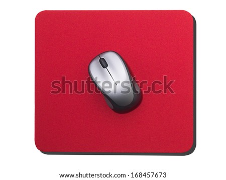 Silver Computer mouse on red mouse mat - stock photo