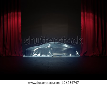 silver covered, New car presentation on show stage - stock photo