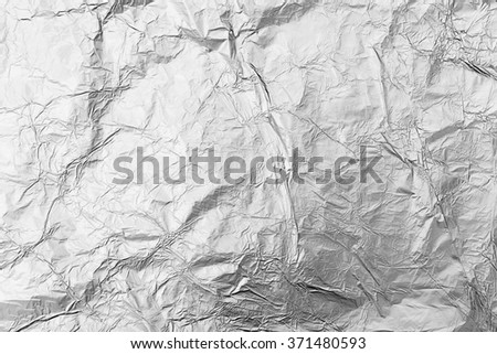 Silver crumpled foil background - stock photo
