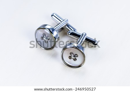 Silver cufflinks - stock photo