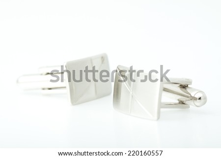 Silver cufflinks on white background. - stock photo