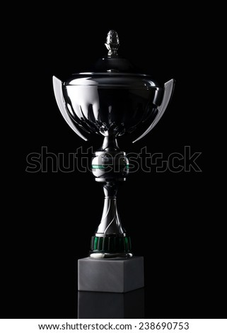 silver cup of the winner on black background - stock photo