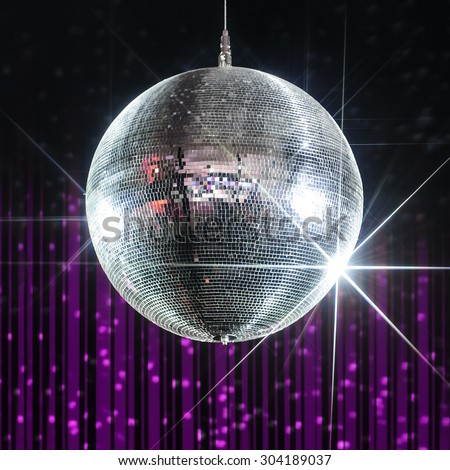Silver disco ball with stars in nightclub with striped violet and black walls  - stock photo