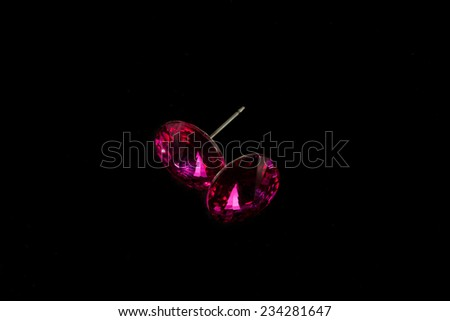 silver earrings with crystals on a black background - stock photo