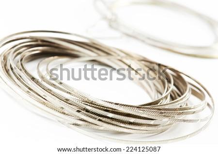 Silver fashion bracelets on a white background. - stock photo