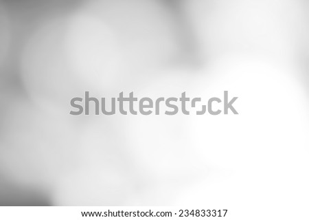 Silver Festive Christmas background. Abstract twinkled bright background with natural bokeh defocused white lights. Holiday party background with blurry special magic effect.  - stock photo