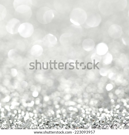 Silver festive glitter background with defocused lights - stock photo