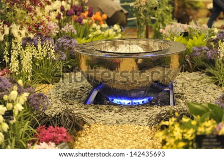 Silver Fire Pit in an English Garden - stock photo