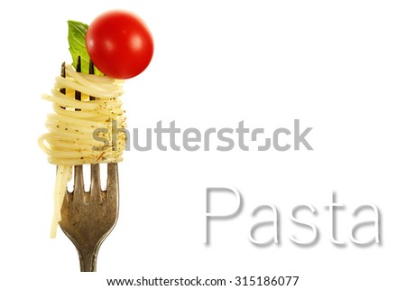 silver fork and pasta and green leaf  - stock photo