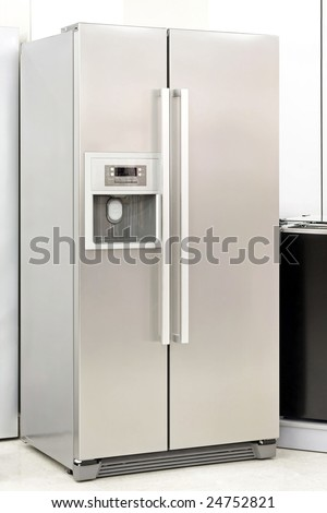 Silver fridge with double doors an ice maker - stock photo