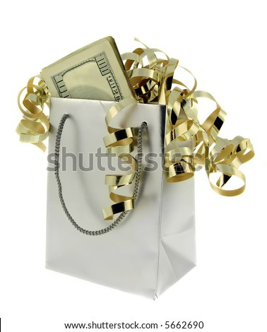 Silver gift bag and money with gold ribbons against a white background. - stock photo