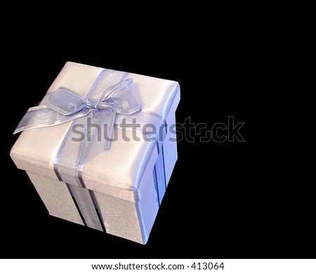 Silver gift box isolated on black - stock photo
