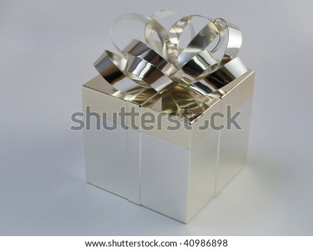 Silver gift box with bow isolated on neutral background - stock photo