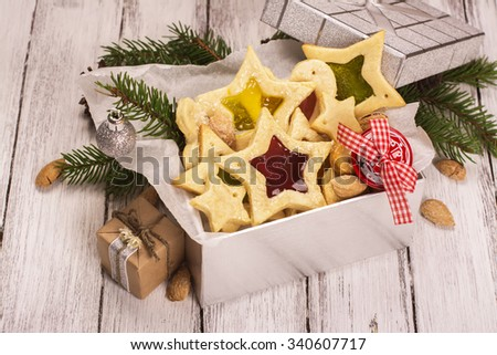 Silver gift box with homemade star shaped cookies. Xmas or new year card. Toned image. Selective focus - stock photo