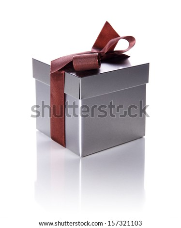 silver gift box with ribbon isolated on white - stock photo