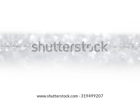 Silver glitter background with beautiful bright bokeh lights and white copy space - stock photo