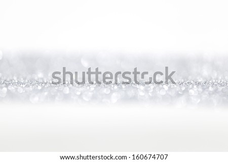 Silver glitter background with white copy space - stock photo