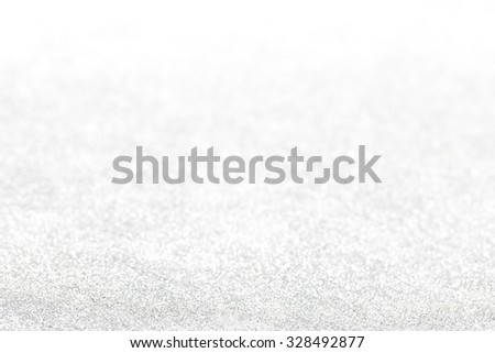 Silver glitter defocused background for new year and christmas - stock photo