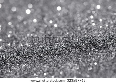 Silver glittering christmas lights. Blurred abstract background - stock photo