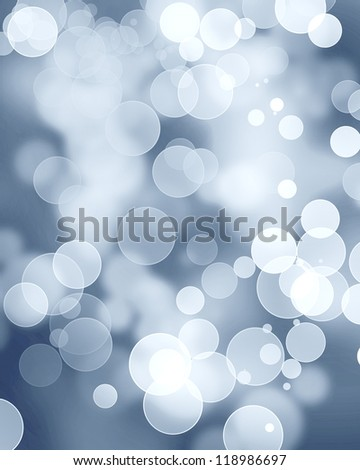 Silver glitters on a soft blurred background with smooth highlights - stock photo