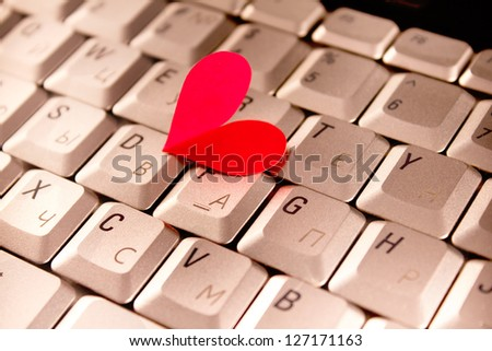silver grey keyboard with red heart for valentines day - stock photo