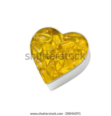 silver heart filled with salmon oil - stock photo