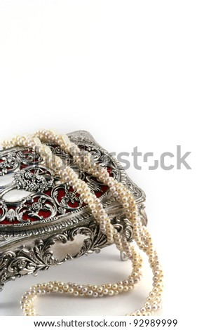 Silver Jewel box with string of pearls - stock photo