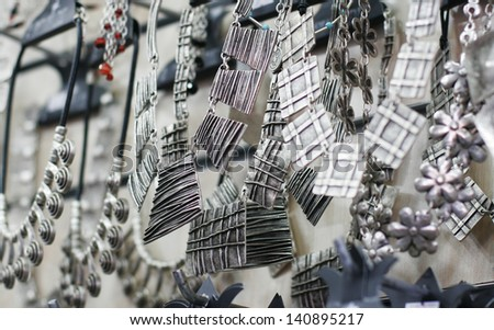 silver jewelry in the shop - stock photo