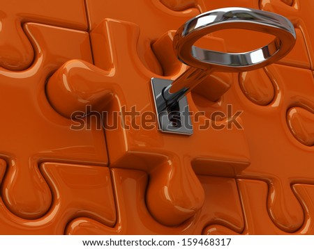 Silver key and orange puzzle pieces - stock photo