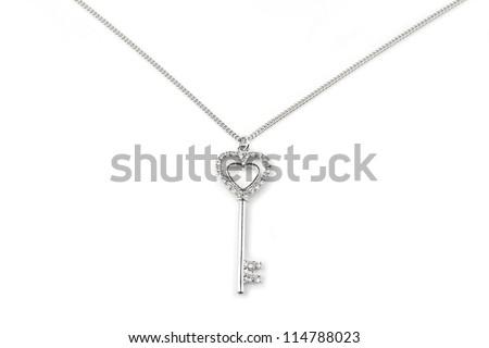 Silver key pendant necklace, Isolated on white - stock photo
