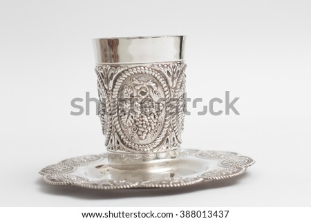 Silver kiddush wine cup and saucer isolated - stock photo
