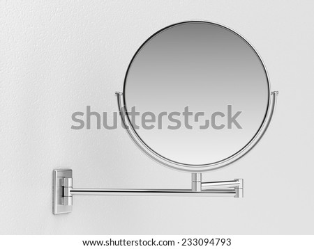 Silver makeup mirror on white wall  - stock photo