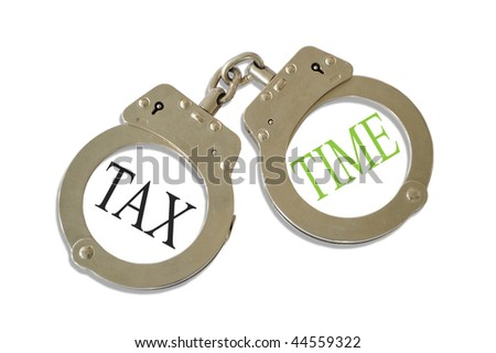 Silver metal handcuffs tax time concept - stock photo