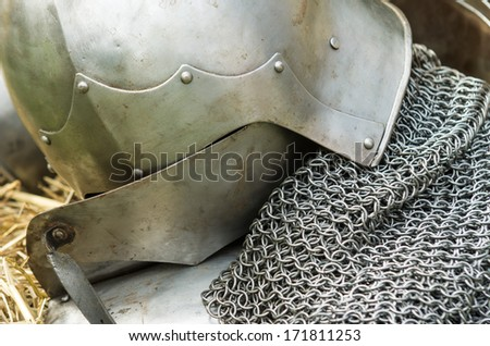 Silver metal helmet and vest as armor protection in medieval tournament - stock photo