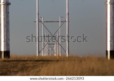 Silver metal power lines in Saskatchewan Canada - stock photo
