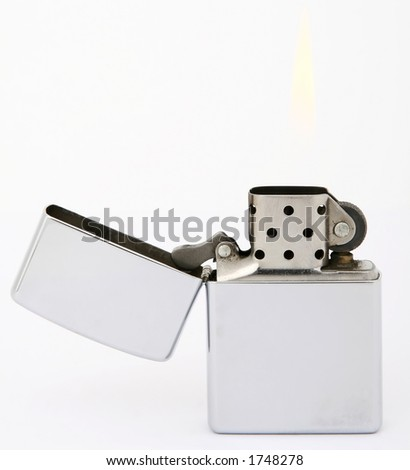 Silver metal zippo lighter for smokers, close-up, macro, copy space, isolated on white - stock photo