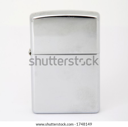 Silver metal zippo lighter for smoking, closeup, macro, copy space, isolated on white - stock photo