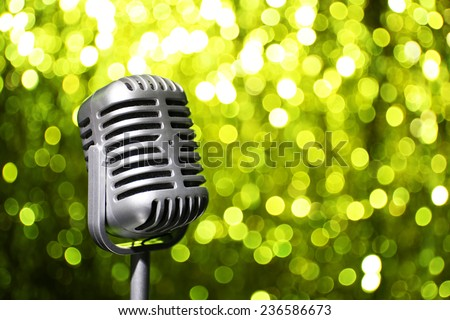 Silver microphone on yellow background - stock photo