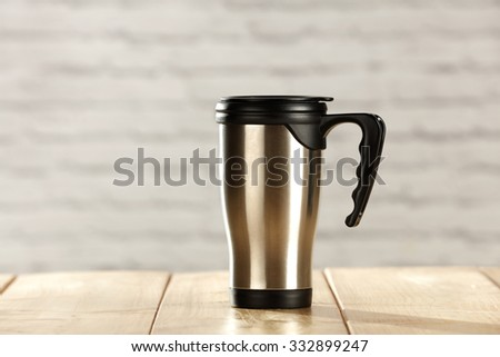 silver mug of hot drink  - stock photo