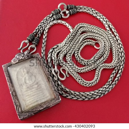 Silver Necklace of Buddha statue - stock photo